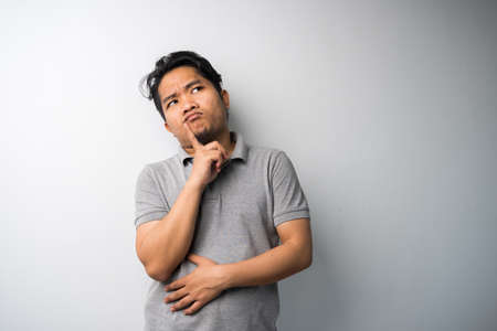 Portrait of Asian man with thinking face expression. looking for new fresh idea.