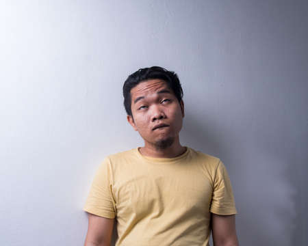 Face reaction, Asian young man portrait of face expression, swag jutsu face as viral on social media. Isolated, selective focus, copy space