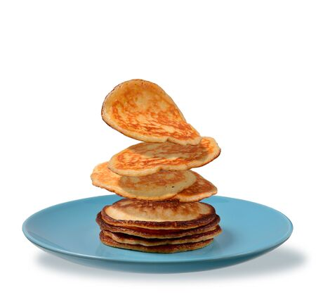 pancakes falling on a blue plate on a white background