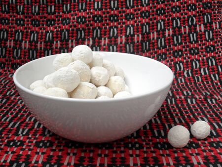 white cup with balls on a colorful background kurut Stock Photo