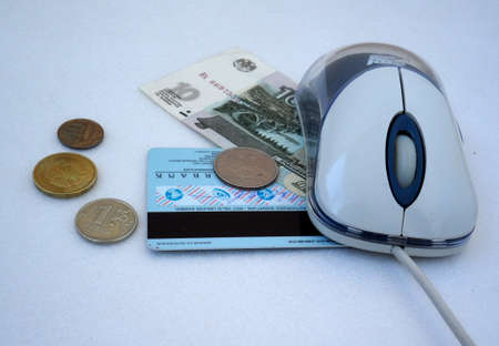 computer mouse, credit card and cash russian money on the gray-white photo