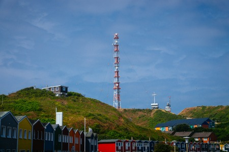 A radio tower on the hills in front of the Hummerbuden of Helgoland Germany in the north sea. Standard-Bild