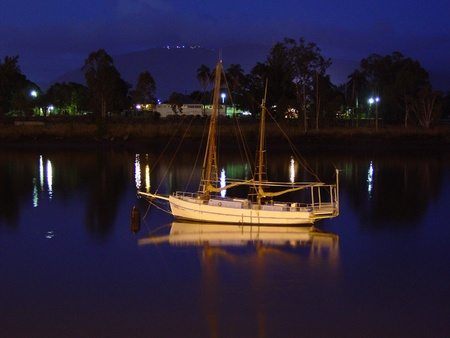fitzroy: An old lugger lays at anchor in a serene river