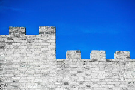 Brick wall and blue sky photo