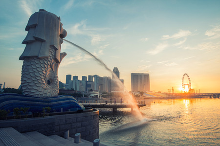 marina bay: Sunrise in The Merlion fountain in front of the Marina Bay Sands hotel