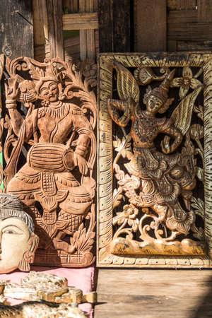 wood carvings: Old wood carvings on the wall temple in Myanmar