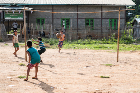 unc: MYANMAR- INLE 15 OCT 2014: Kids playing football in inle 14 oct 2014 from Myanmar. Editorial