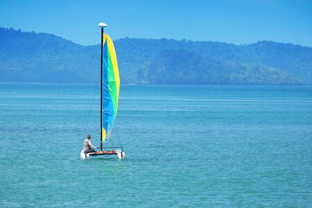 hobie: colorful sailboat and blue water