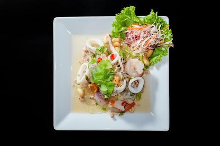 sen: Yum Woon Sen, spicy vermicelli salad in black background