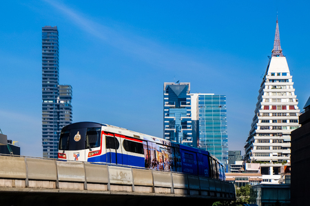 BANGKOK - 15 JAN 2015: A BTS Skytrain on elevated rails in jan 15, 2015 in Bangkok, Thailand. Each train of the mass transport rail network can carry over 1,000 passengers.