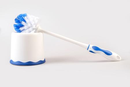 toilet brush: Plastic blue toilet brush isolated on white background Stock Photo