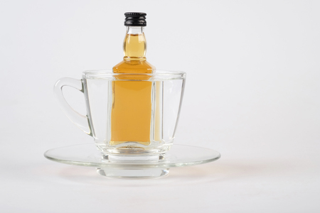 whiskey in cup on white table Stock Photo
