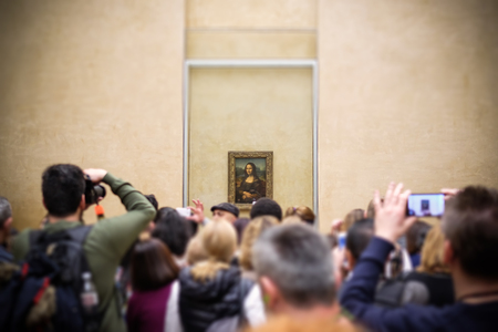 mona lisa: PARIS - MARCH 20: Visitors take photo of Leonardo DaVincis Mona Lisa at the Louvre Museum, March 20, 2015 in Paris, France. The painting is one of the worlds most famous. Editorial