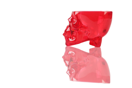 Red skull cup on white isolate