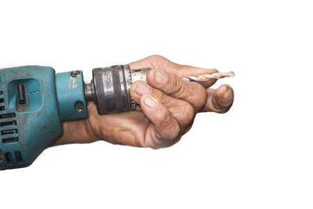 hands hold electric drill on white background