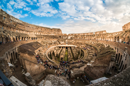 known: ROME - MARCH 23, 2015: Interior of The Colosseum (Coliseum) also known as the Flavian Amphitheatre on a sunny spring day. Arena and hypogeum. One of the main attractions of the city. Rome, Italy.