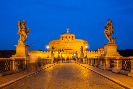 View of the Mausoleum of Hadrian, Saint Angelo castle, Castel SantAngelo (Castle of the Holy Angel) from the Ponte SantAngelo bridge in Rome, Italy with blue sky light.