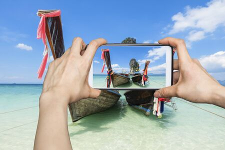 city park boat house: Girl taking pictures on mobile smart phone in poda island karbi,Thailand Stock Photo