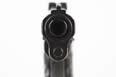 Close up Barrel Snub Nose Revolver Gun Weapon pointed at You Stock Photo