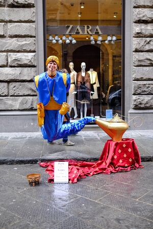 cin: Florence, ITALY - MARCH 27: A female animator Aladdins Genie costume in Old City on florence Street on March 27, 2015 in Florence.