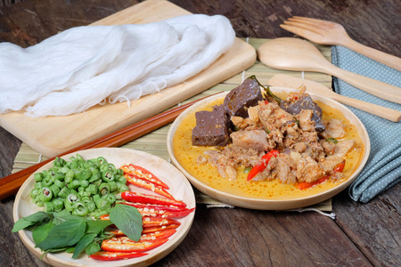 (Kanom jeen) Noodles and Chicken curry with vegetable on wood background Food collection in Thialand