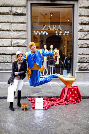 jinni: Florence, ITALY - MARCH 27: A female animator Aladdins Genie costume in Old City on florence Street on March 27, 2015 in Florence.