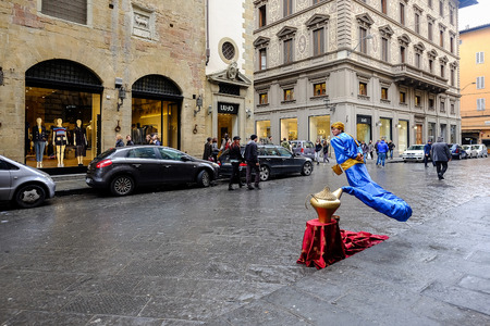 Florence, ITALY - MARCH 27: A female animator Aladdins Genie costume in Old City on florence Street on March 27, 2015 in Florence.