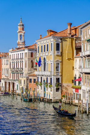 VENICE, ITALY - on MARCH 29, 2015. Old houses and gondola pier ashore Grand channel (Canal Grande). The grand channel is the main transport artery of Venice and its most known channel Editorial