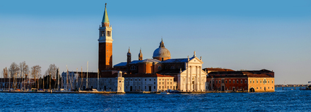 Panorama of San Giorgio Maggiore church in the background in beautiful evening light at sunset, San Marco, Venice, Italy Stock Photo