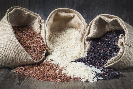 Rice seed,brown rice, keep healthy concept, brown background Stock Photo