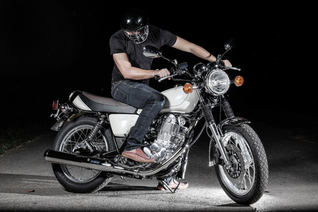 motorsprot: Man seat on the motorcycle on the road Stock Photo