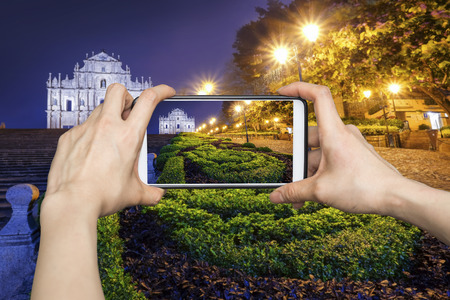 Taking pictures on mobile smart phone in Ruins of St. Pauls, Macau