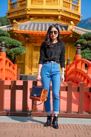 Woman in Front View The Golden Pavilion Temple in Nan Lian Garden Stock Photo