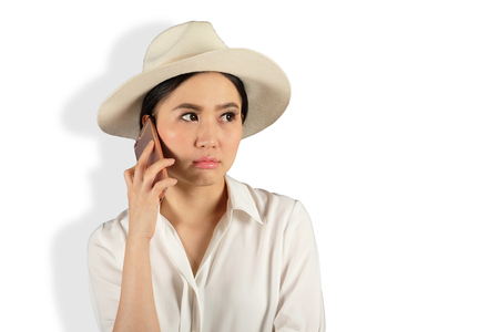 young attractive asian woman waiting answer for a smart phone on White backgroud