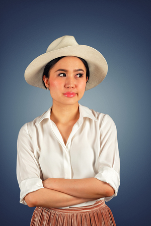 Pretty asian teenager with an impatience and bored expression on white background
