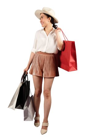 a happy women with shopping bag on white background with clipping path Stock Photo