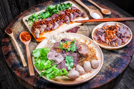 Thai food Noodle soup with beef on wood background