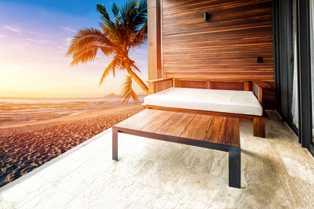 Sofa in living room on morning beach background
