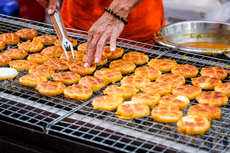 Grilled sticky rice with egg (Khao Jee) street food in Thailand
