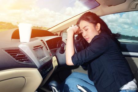 Tired young woman asleep in her car Standard-Bild