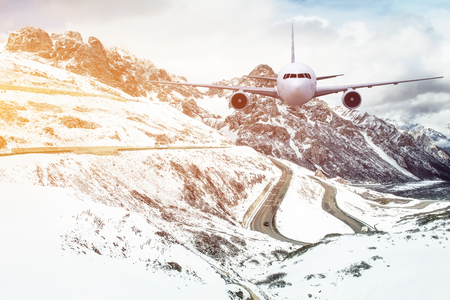 moutain: Airplane frying over the Snow Mountain background