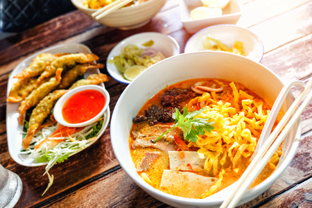 Northern Thai  Curried noodle soup (Khao soi) with chicken meat and spicy coconut milk