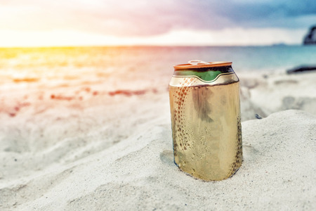 Beer can on the beach