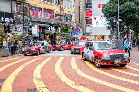 HONG KONG - FEBUARY 10: Red Taxis on the street on Febuary 10, 2017 in Hong Kong. Over 90% daily travelers use public transport. Its the highest rank in the world.