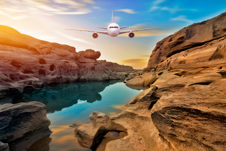 Front of real plane aircraft, on sunset mountain rock background