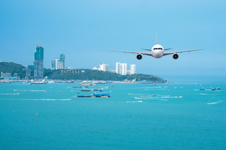 jetliner: Front of real plane aircraft, on Pattaya cityscape background