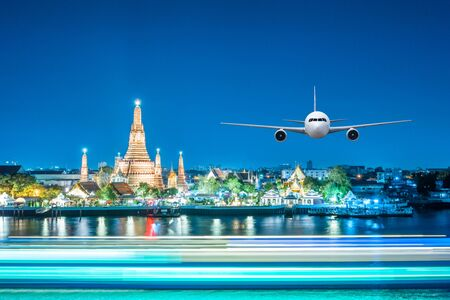 jetliner: Front of real plane aircraft, on Wat arun at Twilight time background