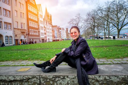 roemerberg: Yound beautiful woman sitting in frankfurt Market, Germany