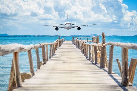 jetliner: Front of real plane aircraft, on sea and wood bridge background Stock Photo