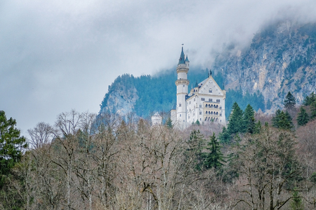 cinderella: Beautiful view of world-famous Neuschwanstein Castle built for King Ludwig in fog near Fussen, southwest Bavaria, Germany